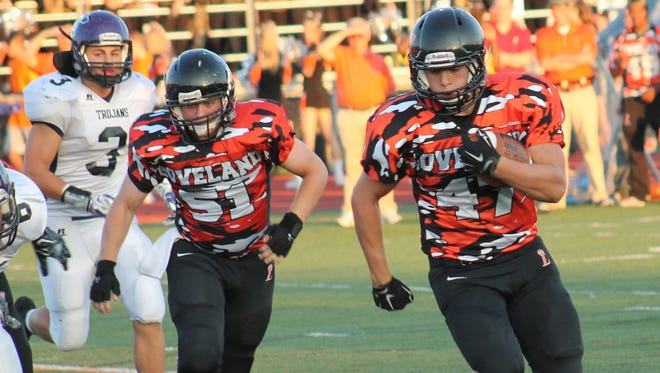 Loveland senior Nate Slagel rolls for a touchdown Sept. 18 against Glen Este.