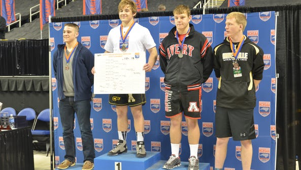 Avery County's Ryan Sheppard, second from right, is