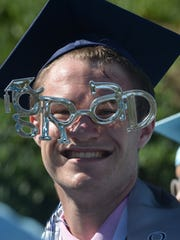 Jack Alcorn models a pair of graduation glasses during