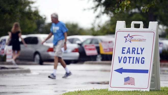 Primary voters head into the polls to cast their ballot early at Wickham Park Community Center in August.