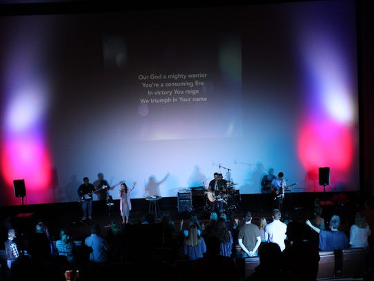 Instead of watching a movie, those at Transformation Church at the new Abilene Cinemark on Sunday morning worshiped.