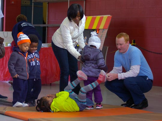 stop, droFirefighter recruit James Chesney, 23 helps kids learn Stop, Drop and Roll.
