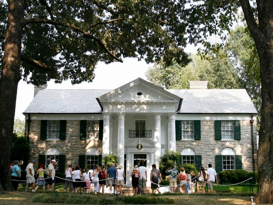 Elvis fans tour the Graceland mansion in 2007.