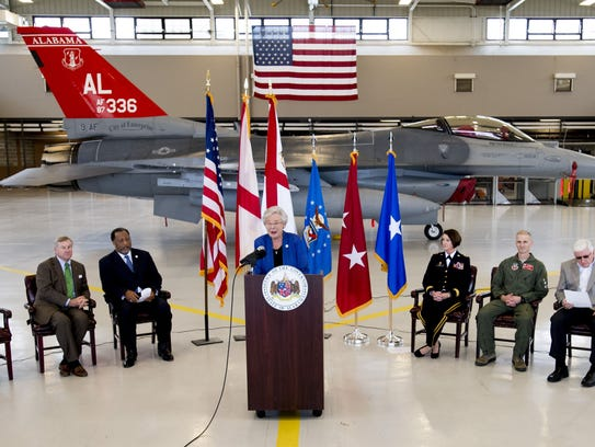 Governor Kay Ivey, backed by a Red-Tail F-16, announces
