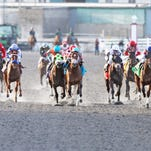 Dubai Sky (No. 12 on rail) won the biggest race of his young career in Saturday's Spiral Stakes at Turfway Park.