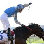 Jockey Luis Saez celebrates aboard Blue Grass Stakes winner Brody's Cause.