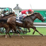 Deceptive Vision and jockey John Velazquez captured Keeneland's Doubledogdare by a head over Lunar Surge (on the rail).