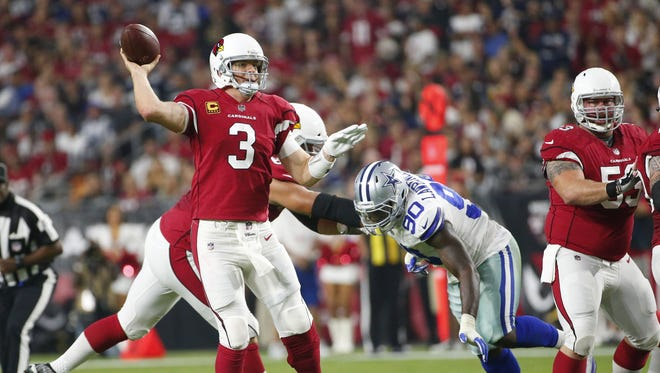 Arizona Cardinals quarterback Carson Palmer (3) throws a pass against the Dallas Cowboys during the first quarter of Monday Night Football at University of Phoenix Stadium in Glendale, Ariz. September 25, 2017.