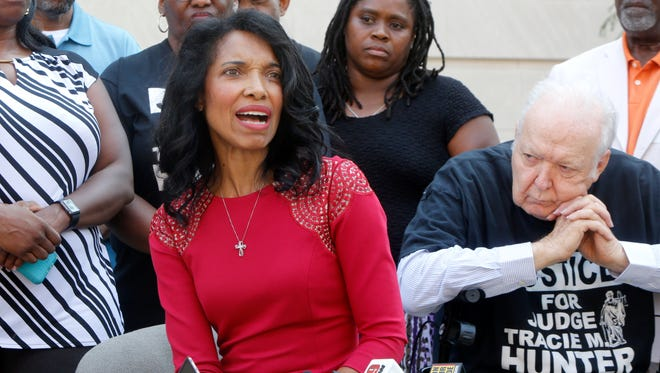 Tracie Hunter speaking at a news conference in August 2017 outside the Hamilton County Courthouse.