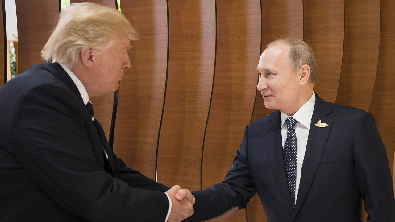 President Trump and Vladimir Putin shake hands