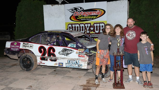 Appleton's Chas Van Ooyen poses with his family after winning the IMCA stock car track championship at Outagamie Speedway in Seymour.