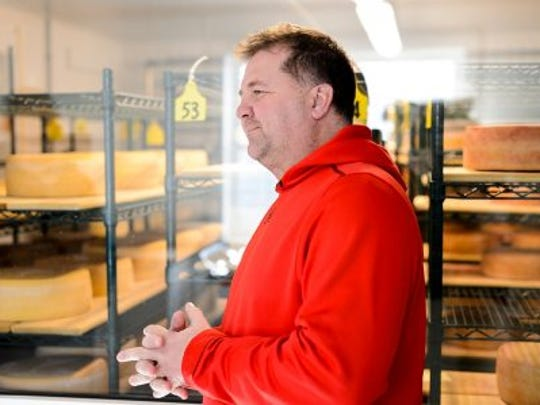 Master cheesemaker Chris Roelli discusses cheese at Roelli Cheese Haus in Shullsburg, Wisconsin. Roelli Cheese created an award-winning product, known as Little Mountain cheese, with the consulting and test-batch help of the Center for Dairy Research at UW–Madison.