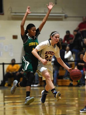Saddle River Day freshman Michelle Sidor (23) protects the ball from defensive pressure applied by Queen of Peace's Forever Toppin in the North Non-Public B final. Sidor scored 21 points in the game to lead SRD to its first state-sectional title.