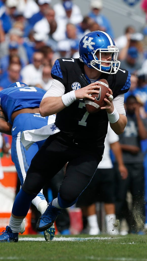 Kentucky Wildcats quarterback Drew Barker during the first half of the spring game in 2014 at Commonwealth Stadium.
