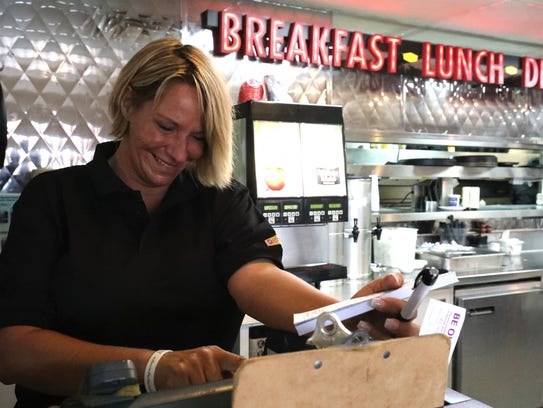 In Key West, Aida  Fortner holds a second waitressing