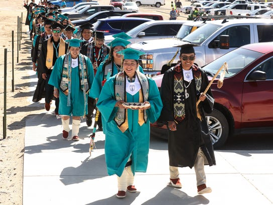 Kyra Capitan, left, and Tristan Joe lead the Navajo