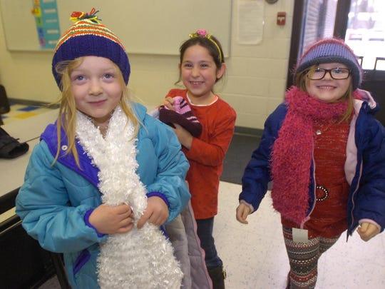 Skilar Dunn (left ) and friends each got new winterwear on Wednesday.