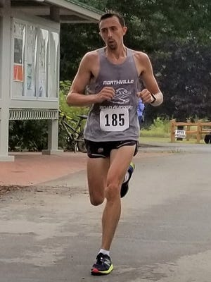 Dan Sowa of Farmington Hills was the overall winner in the 8K at the Northville Road Runner Classic.