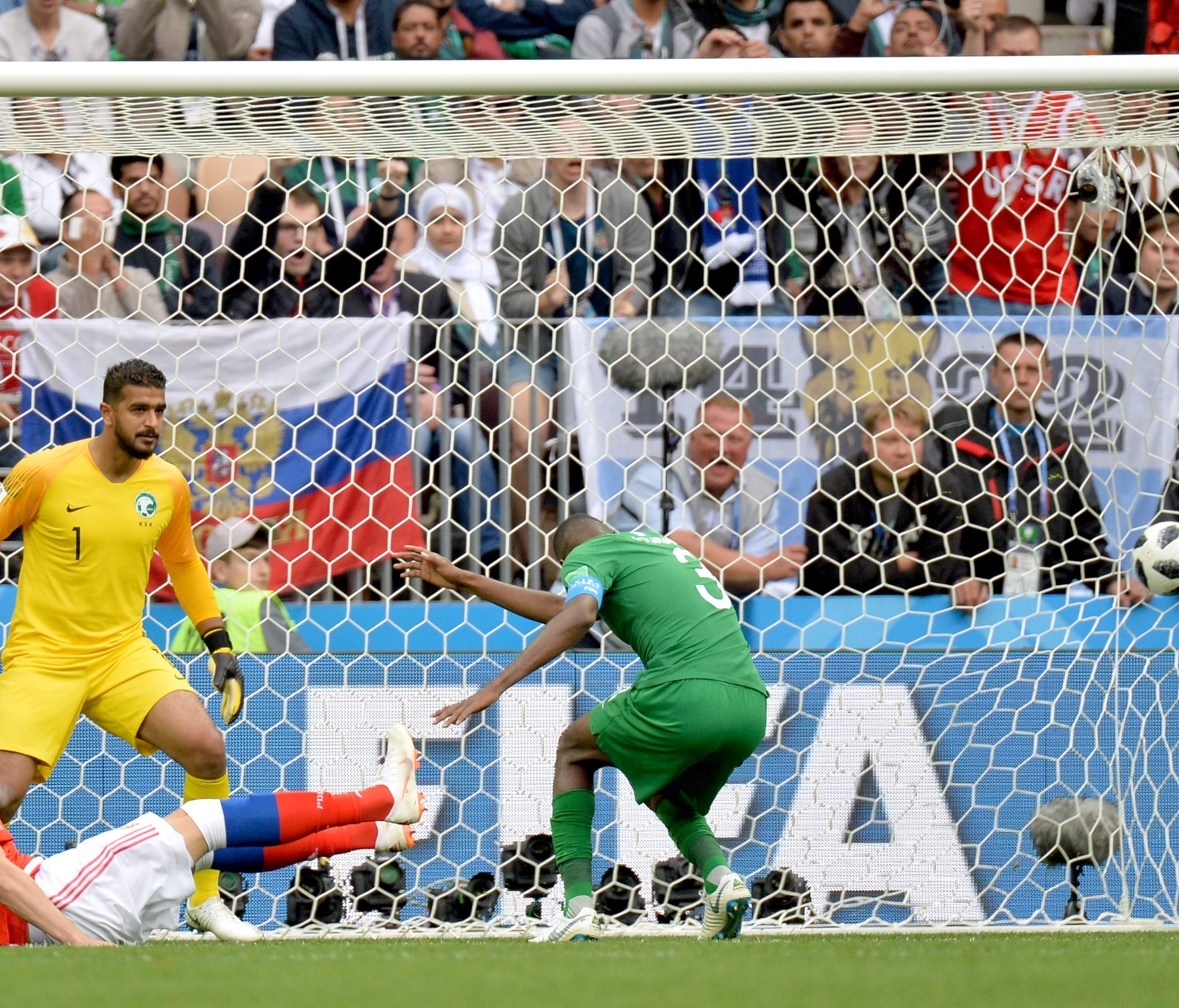 epa06808258 Artem Dzyuba (red shirt) of Russia scores the 3-0 goal during the FIFA World Cup 2018 group A preliminary round soccer match between Russia and Saudi Arabia in Moscow, Russia, 14 June 2018.    (RESTRICTIONS APPLY: Editorial Use Only, not us