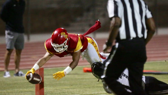Manny Sepulveda scores on a 5-yard run for Palm Desert early in the first quarter of their CIF playoff game Friday night against Saddleback Valley Christian.