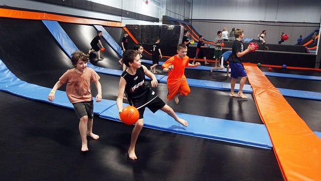 Jumpers play dodgeball at Get Air Salem.