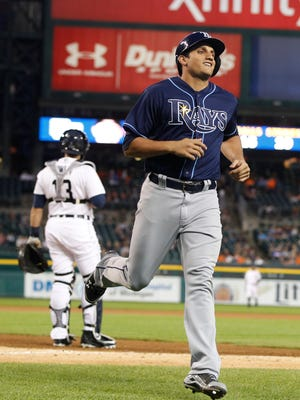 Rays rightfielder Mikie Mahtook smiles after crossing home plate to score against the Tigers at Comerica Park.