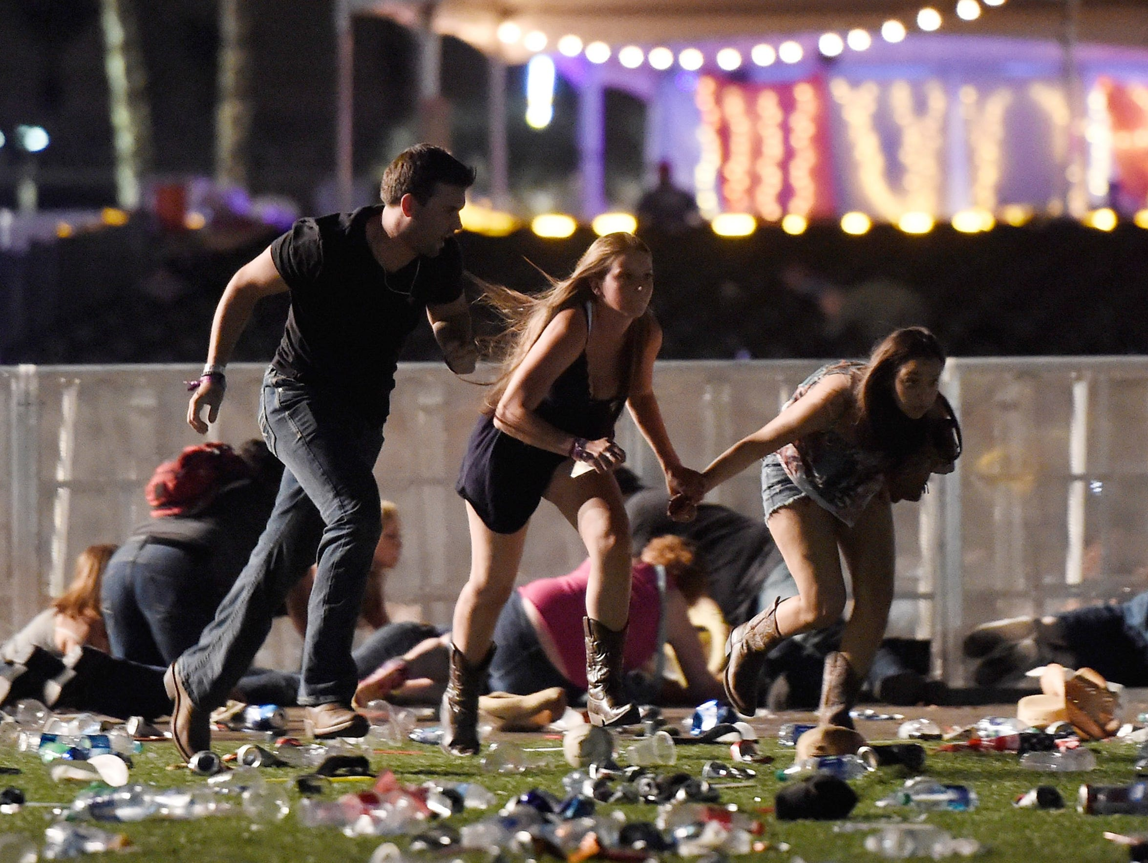 People run from the Route 91 Harvest country music festival after a gunman opened fire on the crowd. Angelica Soto and Carmen Alegria (not pictured) were among more than 400 people injured by gunfire. Fifty-eight people died in the assault. The new podcast Aftermath explores gun violence in America by focusing on survivors.