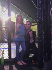Amanda Spivey poses with her 8-year-old daughter before her fight at Chaos 6.