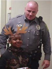Dover Police Cpl. Mickie Price escorted a young participant