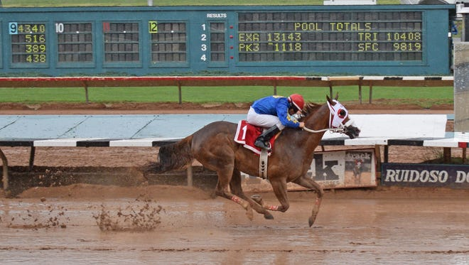 Hold Air Hostage wins his Derby Trial at Ruidoso Downs in the rain and muck. He is in seventh position for Sunday's All American Derby at Ruidoso Downs.