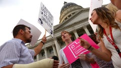 Pro-abortion rights and anti-abortion protesters face-off