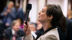 Florida Rep. Elizabeth Porter raises her microphone