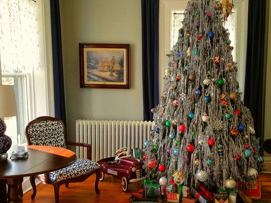 A tinsel-laden tree adorns the parlor in the Lamberson