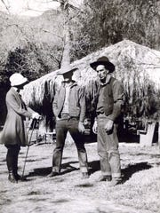 Dr. Florilla White and two actors playing cowboys in a silent movie c. 1920.