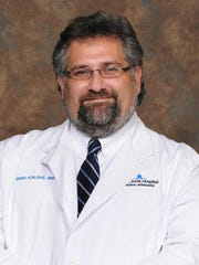 "Dr. Mina ""Mike"" Kalfas, family doctor with The Christ Hospital also is a certified addiction expert in Northern Kentucky."