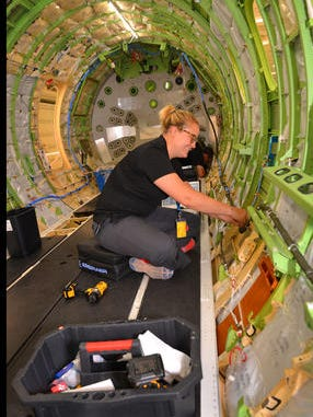Lindsey Leserra, an avionics technician with Embraer, works in the fuselage of a Legacy 450 in their new facility in Melbourne.