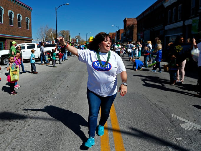Mayoral candidate Kristi Fulnecky waves to parade attendees