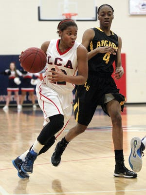 Lafayette Christian's Ajia Robinson (12), shown here in last year's playoff loss to Arcadia, is now the leading scorer for the No. 3-seeded Lady Knights as they begin play in the Class 1A state playoffs Thursday.