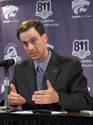 Kansas State athletic director John Currie answers reporters' questions about the future of the Big 12 in June 2010.