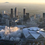 Bus photobombs Weather Channel's view of Georgia Dome implosion