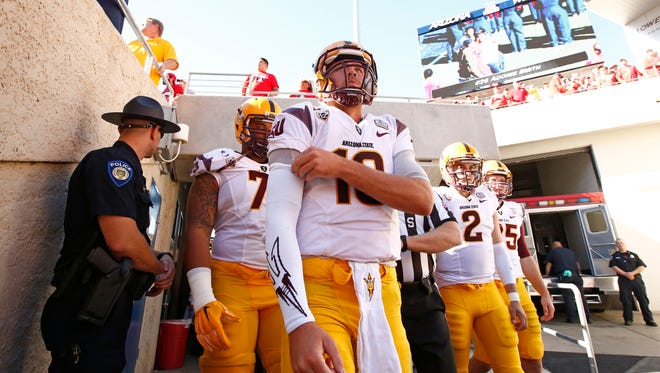 Arizona State quarterbacks Taylor Kelly (10) and Mike Bercovici (2) prepare to take the field against Arizona on Friday, Nov. 28, 2014 in Tucson.