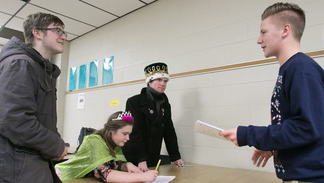 From left, Connor Scott, Morgan Chidester, Robert Lemasters and Joshua Trierweiler, students in a Howell High School AP European history class, work on a French Revolution simulation project Wednesday, Dec. 20, 2017. Classes like this one taught by Dawn Webster could be offered in a non-traditional school planned for the district.