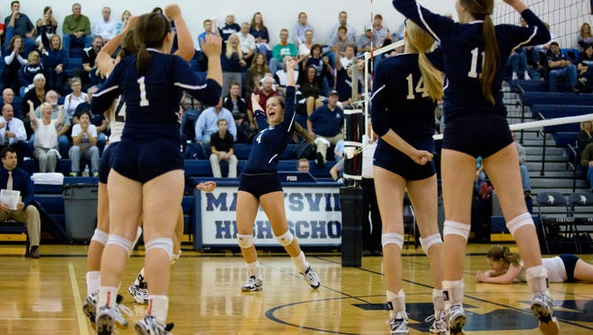 Marysville players celebrate during a volleyball game Tuesday, October 6, 2015 at Marysville High School.