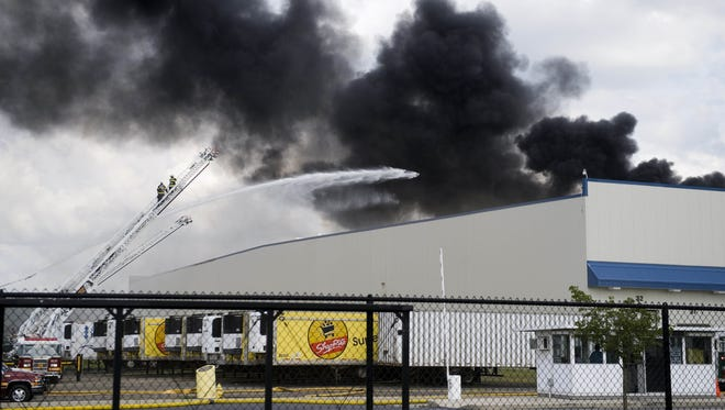 Firefighters work to contain the September 2013 blaze at the Dietz & Watson warehouse in Delanco. The facility was destroyed by the fire.