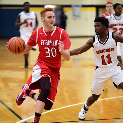 Livonia Franklin senior forward Mark Mettie (30) drives