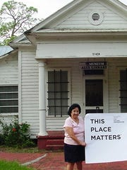 Nina Rigby in front of the Alva Library, which houses the Alva Museum.