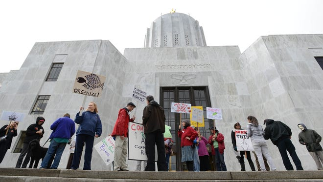 Protesters rally against banning Oregon counties from regulating GMOs during a special session in 2013.