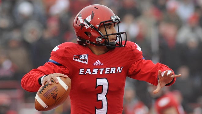 Eastern Washington Eagles quarterback Vernon Adams (3) drops back for a pass against the Towson Tigers during the first half at Roos Field.