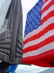 Two of the patriotic-themed hot-air balloons set to launch during the El Paso Balloon Festival are the Space Shuttle Patriot and an American flag.