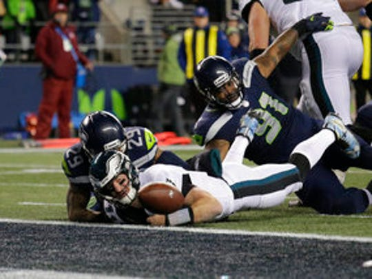 Philadelphia Eagles quarterback Carson Wentz (11) fumbles the ball near the goal line and into the end zone as Seattle Seahawks' Earl Thomas (29) and Sheldon Richardson (91) moved in in the second half during a game last December.
